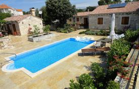 Houses with pools by the sea for sale in Sibenik-Knin. The house is in a traditional Dalmatian style, 250 meters from the sea in Rogoznica