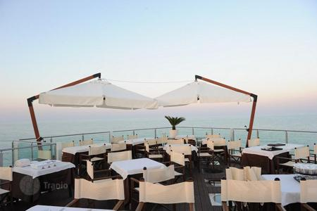 Property for sale in Abruzzo. The restaurant features a private beach area in Pineto, Italy