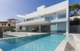 Luxury houses with pools for sale in Majorca (Mallorca). New villa with a swimming pool, panoramic windows and a rooftop terrace with sea views, Cala Ratjada, Mallorca, Spain