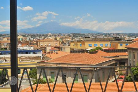 Apartments for sale in Sicily. Renovated penthouse with a terrace of 40 m², views of the city, the sea and mount Etna in the center of Catania, Sicily