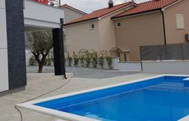 Houses with pools by the sea for sale overseas. Villa in Razanj
