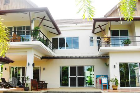 Houses for sale in Southeast Asia. Two-storey furnished villa with pool, garden and parking near the British International School in Phuket