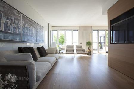 Luxury property for sale in Lombardy. Duplex penthouse with two large terraces with panoramic views of the city, in Milan