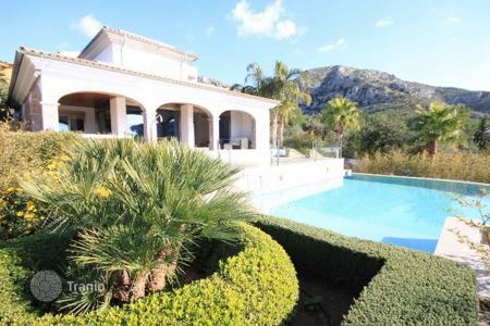Houses with pools for sale in Alcudia. Outstanding luxury villa with private lift, sea views in exclusive Bon Aire, near Alcudia, Spain