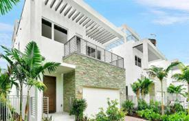 Property for sale in North America. New house with a pool, a garage and ocean views in Sunny Isles Beach, Florida, USA