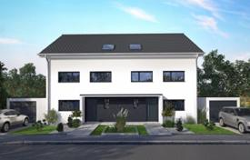 Off-plan residential for sale in Bavaria. Stylish townhouse with a terrace, a hobby room and a garden, Munich, Bavaria, Germany