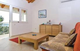 Residential for sale in Dubrovnik Neretva County. Spacious family seaview cottage on a plot with a swimming pool and a large garage, within walking distance from a beach, Orebić, Dubrovnik