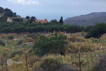 Cheap land for sale in Crete. Plot of land in a quiet mountain area with spectacular views of the mountains and the sea, in the village Kunavi