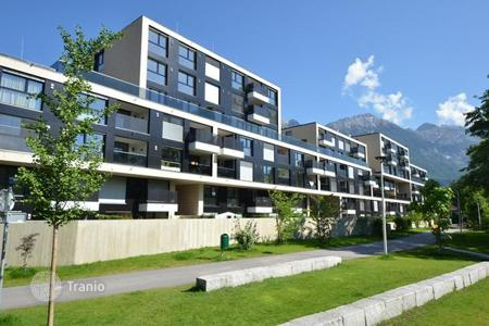 New homes for sale in Tyrol. Modern apartment with a balcony, with spectacular views of the mountains and the park, in the new house, Innsbruck, Austria