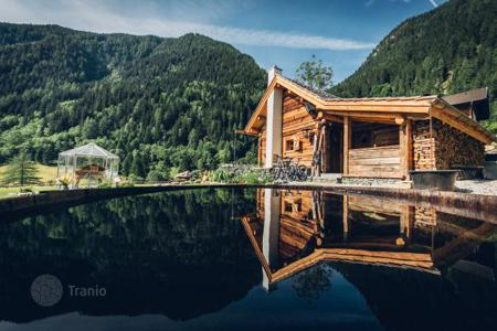 Chalets for sale in Carinthia. New lake chalet with a sauna and a view of the mountains, near a ski resort, Flattach, Austria