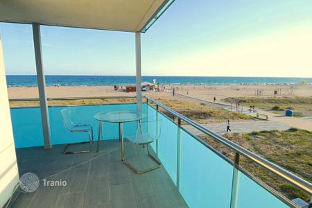 Property for sale in Castelldefels. Apartment with terrace on the sea front in Castelldefels, Spain