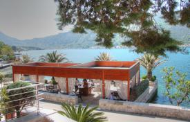 Luxury houses for sale in Kotor. Frontline villa with private mooring in the Bay of Kotor
