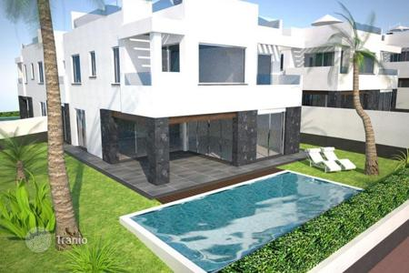 Off-plan property for sale in Tenerife. Luxury villa with an underground garage and terrace in a new complex in the center of Los Cristianos, Tenerife