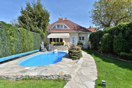 Residential for sale in Central Bohemia. A two-storey house with pool and garden in Ricany, Czech Republic