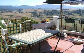 Cheap townhouses for sale in Andalusia. Renovated townhouse with a picturesque view of the valley, a spacious terrace and a small garden, Jimena de la Frontera, Andalusia