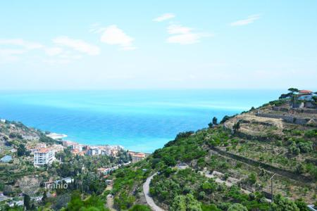 Off-plan houses for sale in Italy. Plot of land with an approved project in Bordighera