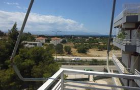 Cheap apartments for sale in Greece. Apartment with sea view and roof top terrace, in Loutrakion, Greece