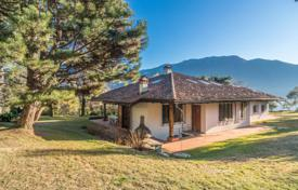Luxury houses for sale in Lenno. Beautiful hillside villa with a large park, a swimming pool and a lake view in a private residence, Lenno, Italy