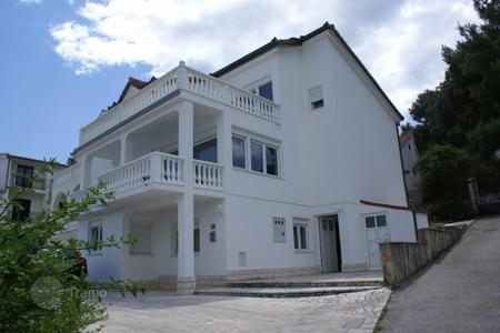 Coastal houses for sale in Split-Dalmatia County. Furnished house with three apartments with private entrances and terraces, near the sea, in a quiet district, Trogir. Although negotiable!