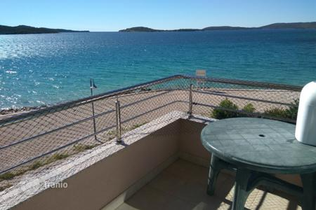 Coastal residential for sale in Sibenik-Knin. Penthouse first line to the sea