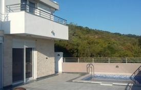 Modern villa with a plot, a garage, a swimming pool, a terrace and sea and mountain views, Uteha, Montenegro for 460,000 €