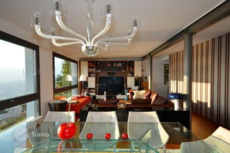 Property to rent in Switzerland. Modern villa overlooking Lake Lugano, Aldesago, Switzerland
