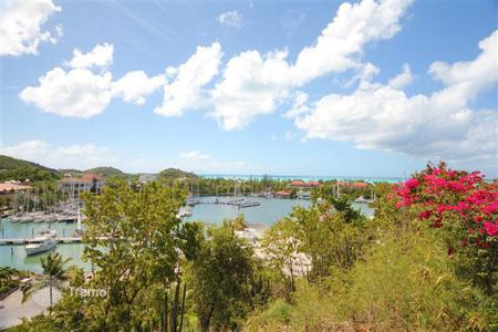 Land for sale in Jolly Harbour. Magnificent hillside lots commanding stunning views over the marina