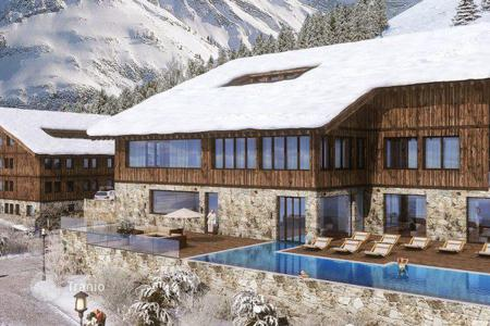 Apartments with pools for sale in Austrian Alps. Apartments in a new residence with a wide range of services near the ski slope in the Alps, Warth am Arlberg