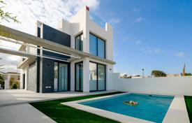 Coastal houses for sale in Spain. New villa with a pool and a garden 150 meters from the sea in Torrevieja