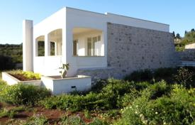 Residential for sale in Apulia. Two villas with a swimming pool and a garden near the sea, Torre Mozza, Italy