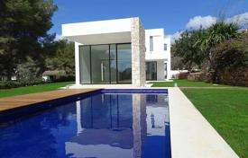 Houses with pools by the sea for sale in Alicante. Designer villa 200 meters from the sea in Moraira, Alicante, Spain