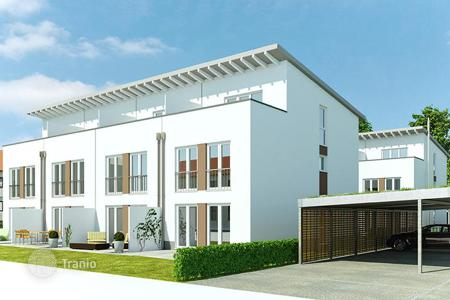 Apartments for sale in Freiburg. New townhouses with terraces, gardens and a personal parking on the river bank in Freiburg