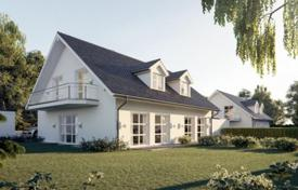 Off-plan residential for sale in Bavaria. Modern house with a garden and a garage in the prestigious district of Grünwald, Munich, Germany