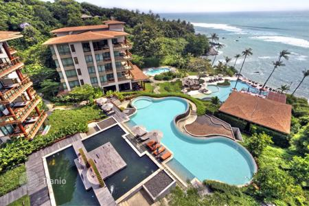 Apartments for sale in Southeast Asia. Three-room apartment with terrace and views of the ocean in Laem Set, Koh Samui, Thailand