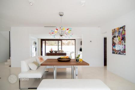 Property to rent in Balearic Islands. Designer villa with terraces, infinity pool and panoramic views of the sea and islands for rent between Sant Josep and Cala Tarida, Ibiza
