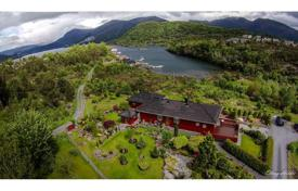 Property for sale in Norway. Upgraded mansion with a large outdoor terrace on the beach