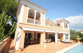 Luxury 4 bedroom houses for sale in Balearic Islands. Villa with a garden, a pool, a garage and a sea view, Calvia, Spain