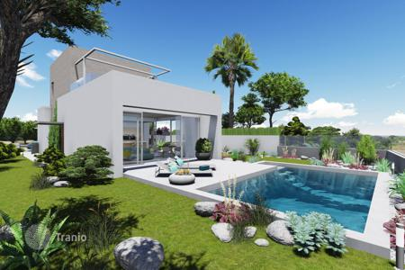 Houses with pools for sale in Cabo Roig. New detached house in Orihuela, Spain. Large terrace of 50 m², sea view, swimming pool and garden