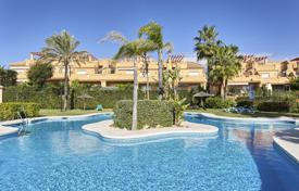 Townhouses for sale in Estepona. Spacious townhouse with a terrace, a garage and a sea view in a residential complex with gardens and swimming pools, Estepona, Spain
