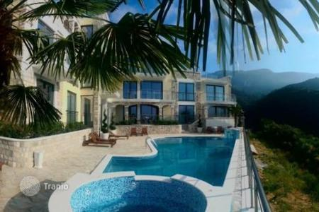 Apartments with pools for sale in Becici. 3-bedroom apartment in a residential complex in the village of Becici, Budva Riviera, Montenegro