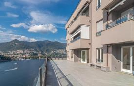 4 bedroom apartments for sale in Lombardy. Spacious apartment with 2 terraces overlooking Como Lake in an exclusive residential complex, Lombardy, Italy