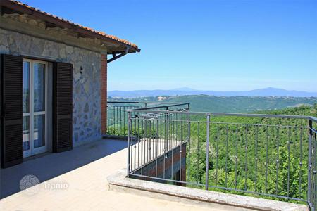 Cheap apartments for sale in Italy. Portion of the stone house with large terraces and private land for sale in Umbria