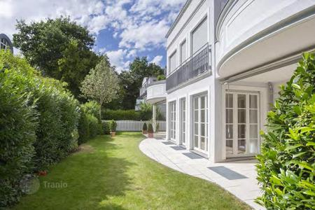 Luxury apartments for sale in Munich. Two-level apartment with an elevator, a private garden and five terraces, in a quiet district of Munich, Germany