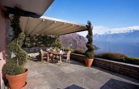 Bank repossessions residential in Lombardy. Set in prestigious and exclusive Residence with swimming pool, a beautiful villa with large terraces and stunning panoramic lake views