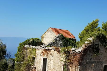 Development land for sale in Croatia. Stone houses with courtyard
