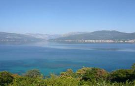 Coastal development land for sale in Montenegro. Investment plot with an amazing sea view situated only 8 m from the seaside in Bogisici, Bay of Tivat, Montengro