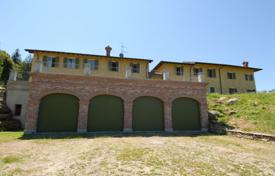 Farm with a spacious villa with a terrace, lake views and huge farmlands, Luino, Lombardy, Italy. Price on request