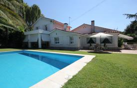 Houses with pools for sale in Madrid. Beautiful villa with terraces and a swimming pool in the district of Aravaca, Madrid, Spain
