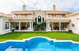 Houses with pools for sale in Lisbon. Luxury villa with well-tended garden and a private swimming pool in Cascais