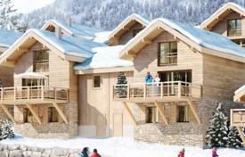Chalets for sale in France. New three-storey chalet with a balcony and a garage, in a popular resort village, next to the ski lift, Isère, Alpes, France